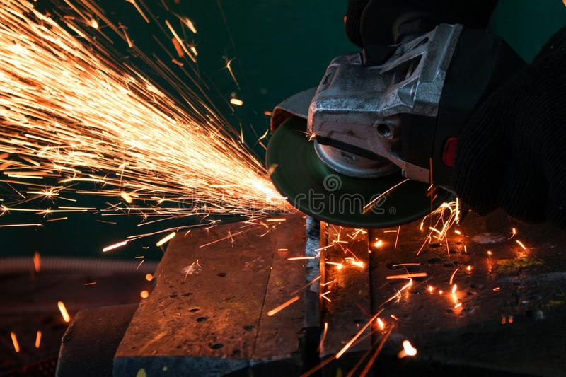 work as a grinder, metal cutting, sparks from metal cutting stock photos