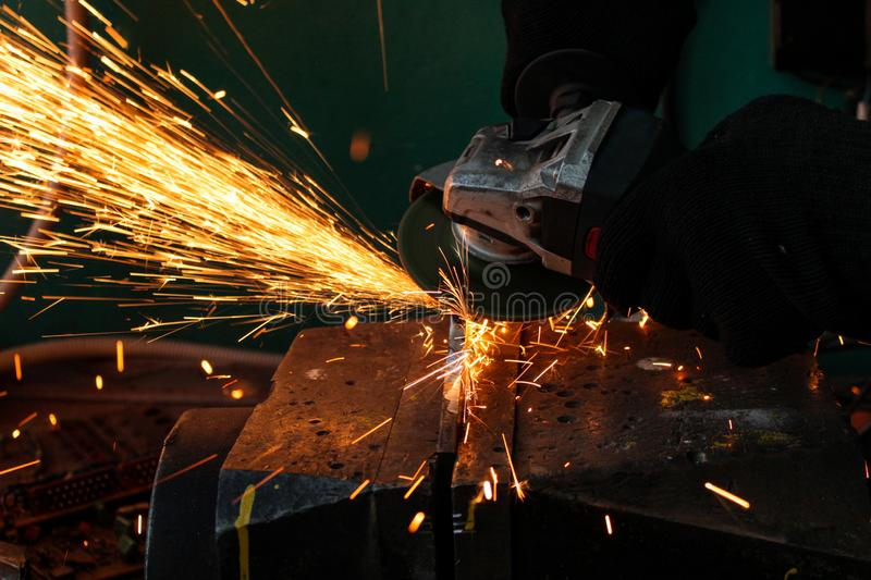 work as a grinder, metal cutting, sparks from metal cutting stock photo