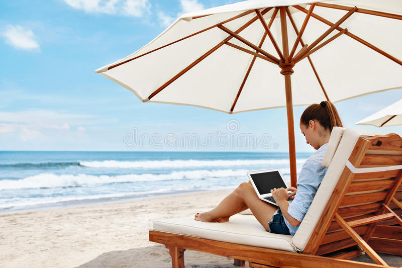 Work At Beach. Business Woman Working Online On Laptop Outdoors. Work At Beach. Successful Freelancer Business Woman Working Online In Internet On Laptop royalty free stock photography