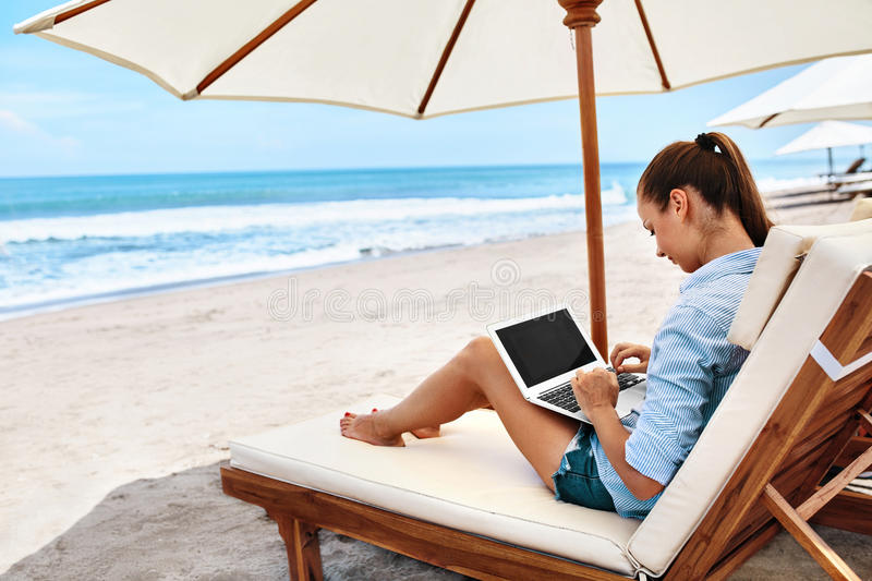 Work At Beach. Business Woman Working Online On Laptop Outdoors. Work At Beach. Successful Freelancer Business Woman Working Online In Internet On Laptop royalty free stock photo