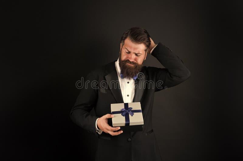 Work birthday. Bearded businessman choose birthday present. Gift shop. Celebrating birthday. Birthday greetings. Anniversary. Special occasion. Holiday stock image