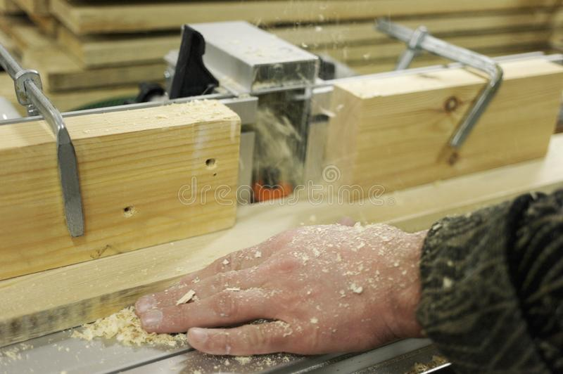 Work with Board and batten on the milling machine. Processing boards on a milling machine royalty free stock photos