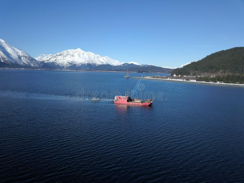 Work boats working on Resurrection bay Alaska royalty free stock photography