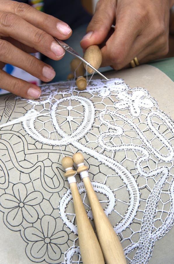 Woman - hands - work - bobbin. Detail of hands working the bobbin stock image
