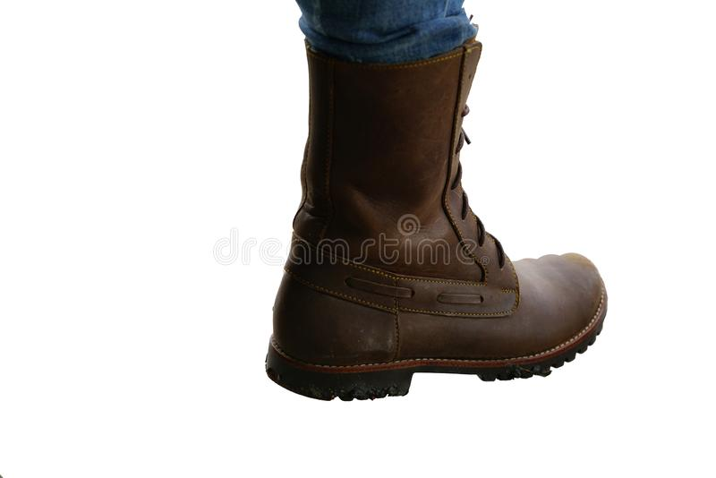 Work boot brown color and blue jean leg isolated on white background royalty free stock images