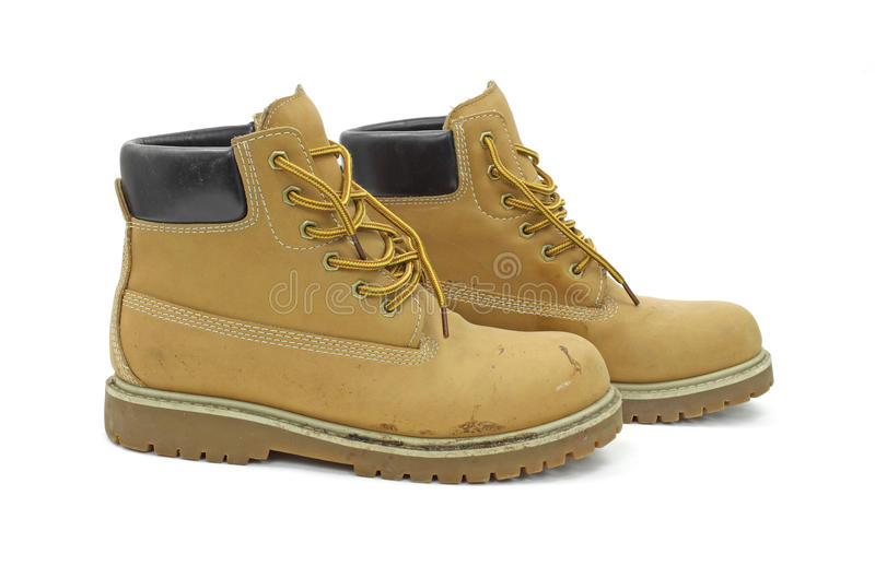 Work boots. A pair of worn work boots on a white background royalty free stock photography