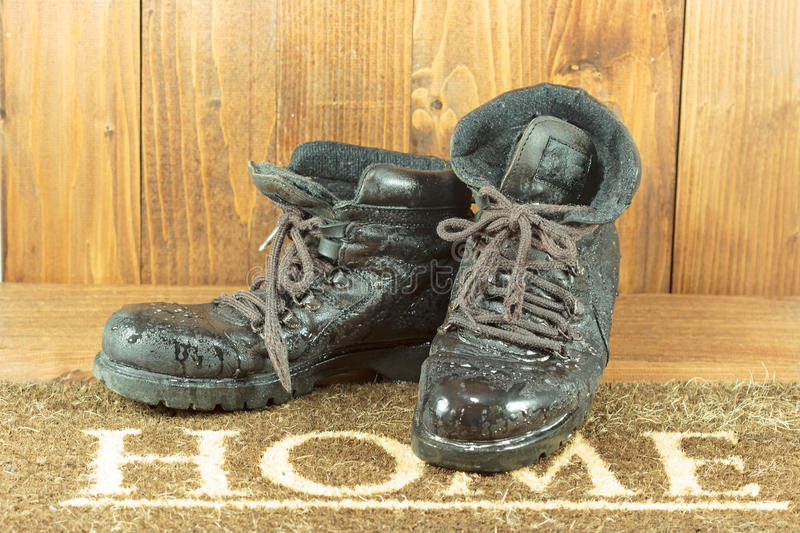 Work boots on the doorstep stock photo