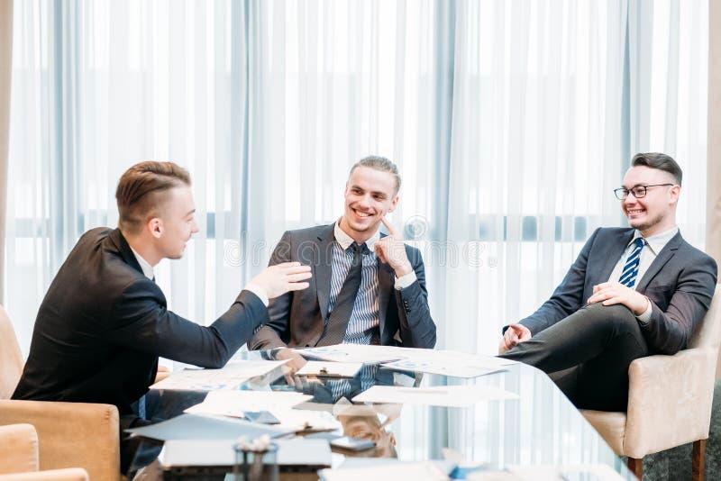 Work break team laughing joking office meeting. Work break. business team of company executives laughing and joking during office meeting. friendship royalty free stock photos