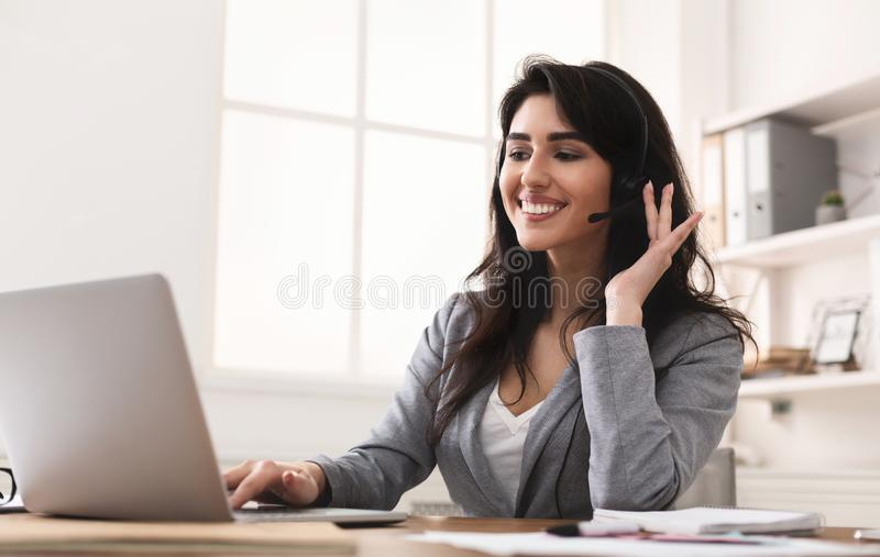 Work In Callcenter. Female Secretary With Headset royalty free stock image