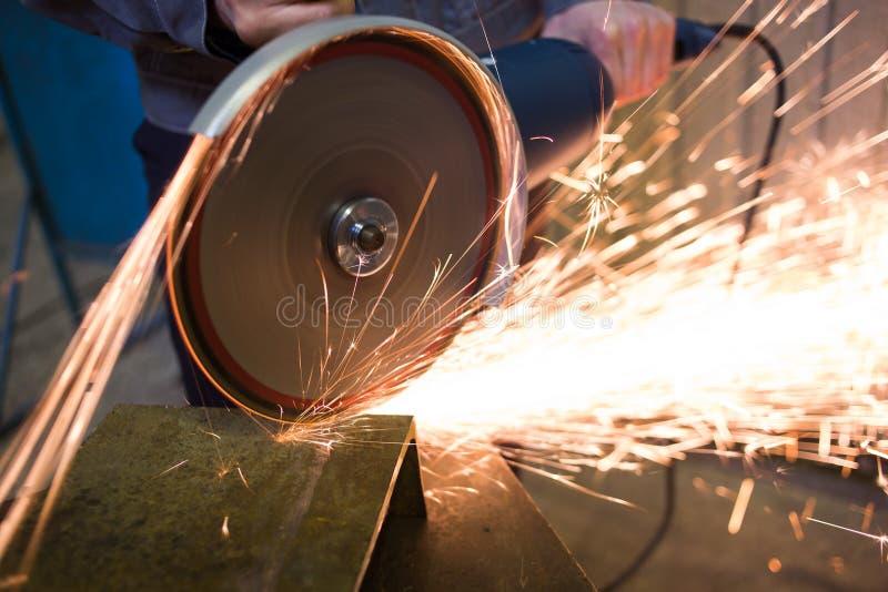 Work circular saw. Huge amount of sparks stock photos