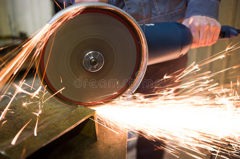 Work circular saw. Huge amount of sparks royalty free stock photo
