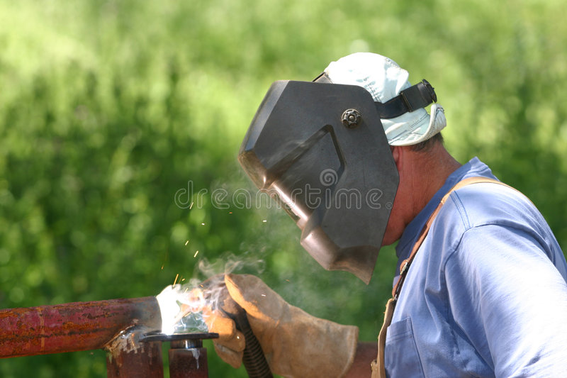 Work day. Welding, with hood and gloves royalty free stock photography