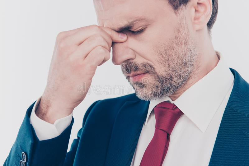 Work depression concept. Cropped close up photo of sad upset nervous freelancer with closed eyes suffering from headache wearing r royalty free stock photo