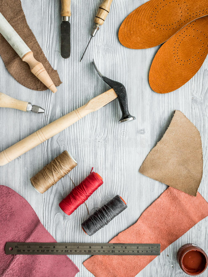 Work desk of clobber. Skin and tools on grey wooden desk background top view.  stock images
