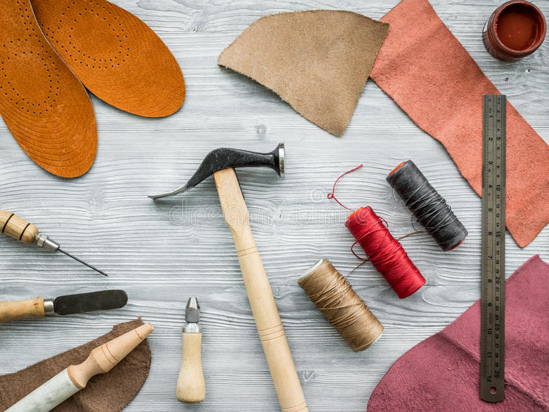 Work desk of clobber. Skin and tools on grey wooden desk background top view.  royalty free stock image