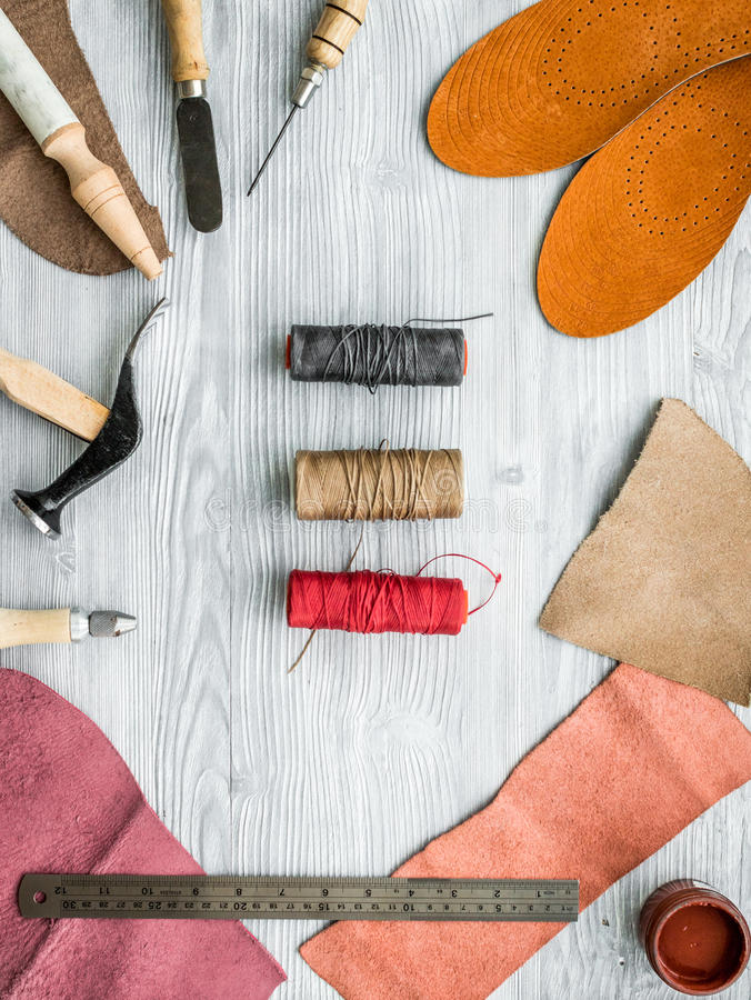 Work desk of clobber. Skin and tools on grey wooden desk background top view.  royalty free stock photo