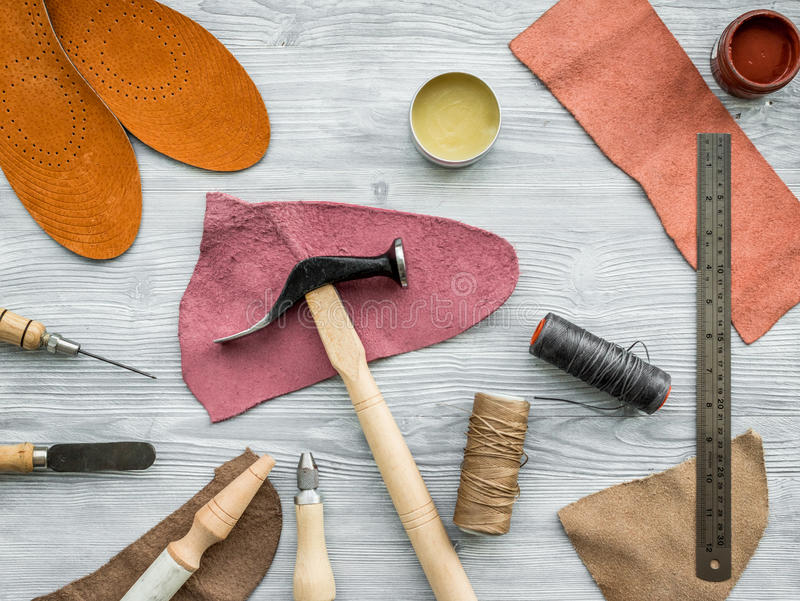 Work desk of clobber. Skin and tools on grey wooden desk background top view.  royalty free stock images