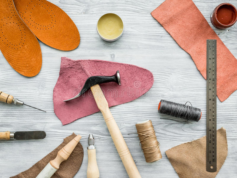 Work desk of clobber. Skin and tools on grey wooden desk background top view.  royalty free stock photos