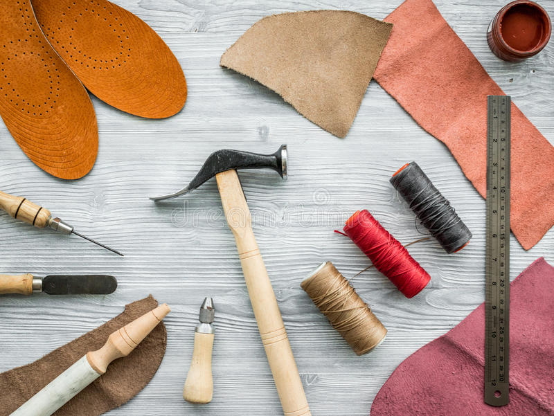Work desk of clobber. Skin and tools on grey wooden desk background top view.  royalty free stock photography