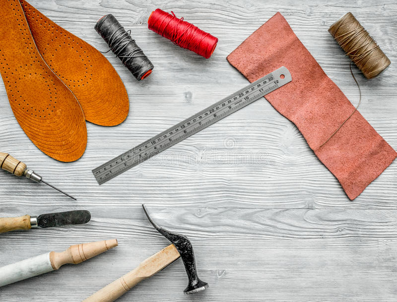 Work desk of clobber. Skin and tools on grey wooden desk background top view copyspace.  royalty free stock photo