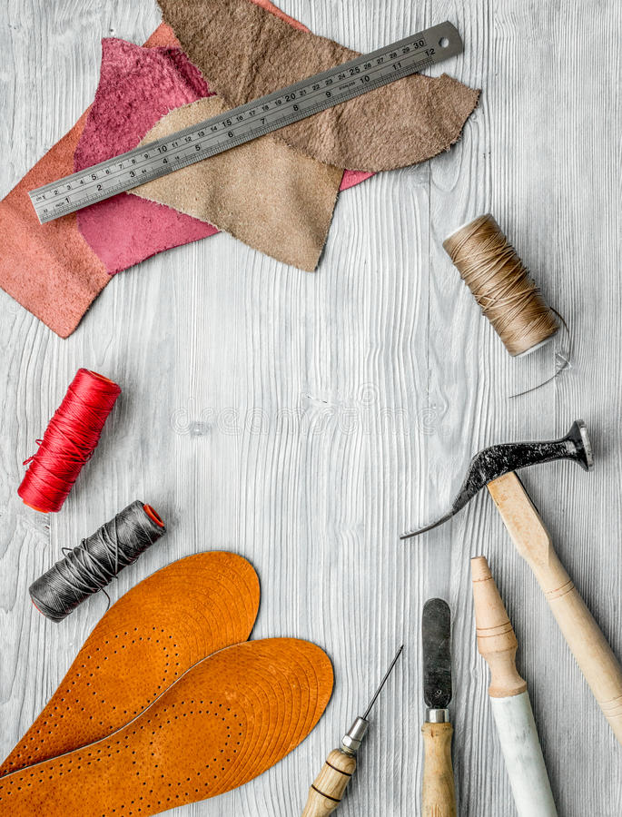 Work desk of clobber. Skin and tools on grey wooden desk background top view copyspace.  stock photography
