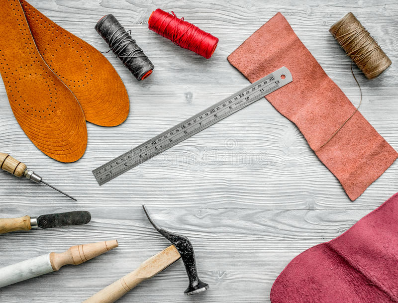 Work desk of clobber. Skin and tools on grey wooden desk background top view copyspace.  stock images