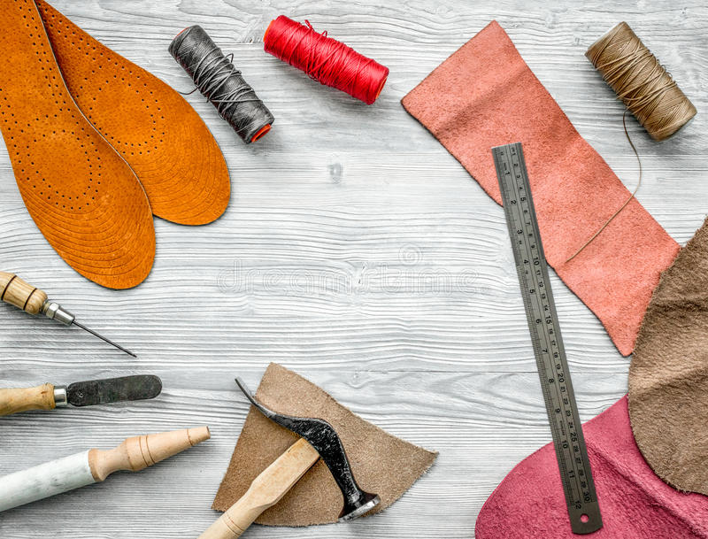 Work desk of clobber. Skin and tools on grey wooden desk background top view copyspace.  stock photo