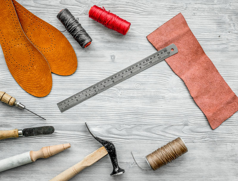 Work desk of clobber. Skin and tools on grey wooden desk background top view copyspace.  royalty free stock image