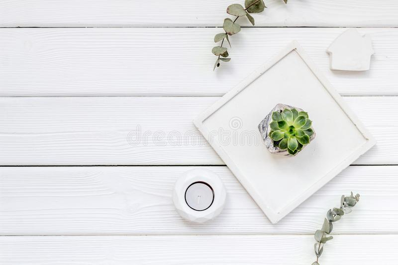 Work desk design with concrete decorations, candle and plant on white wooden background top view space for text. Home office. Work desk design with concrete royalty free stock photo