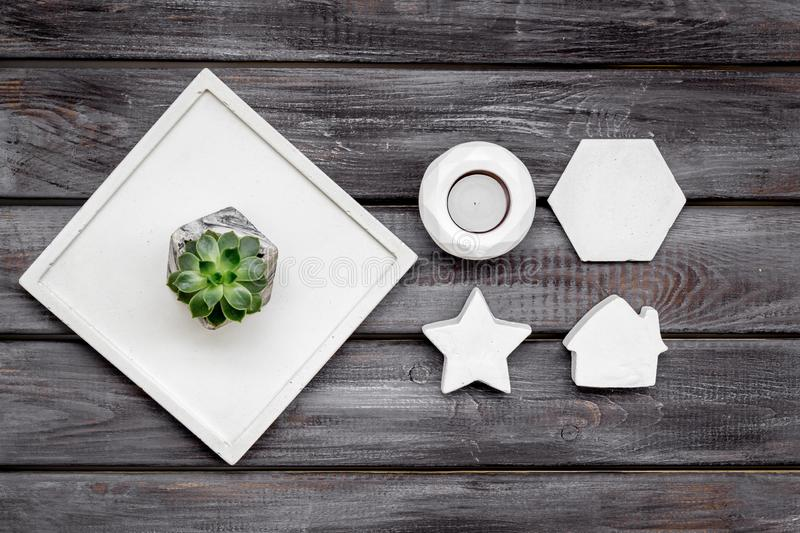 Work desk design with concrete decorations, candle and plant on wooden background top view. Home office. Work desk design with concrete decorations, candle and royalty free stock photos