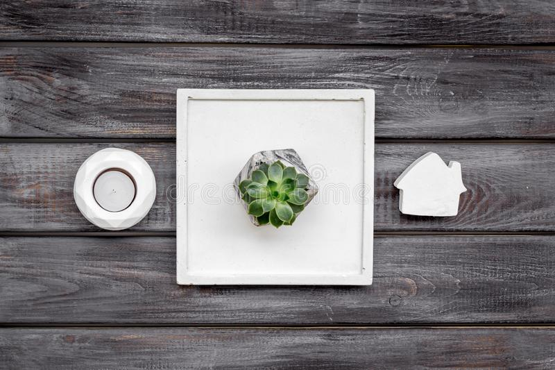 Work desk design with concrete decorations, candle and plant on wooden background top view. Home office. Work desk design with concrete decorations, candle and royalty free stock images