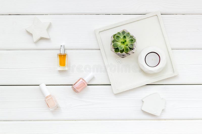 Work desk design with concrete decorations, nail polish and perfume on white wooden background top view. Home office. Work desk design with concrete decorations stock images