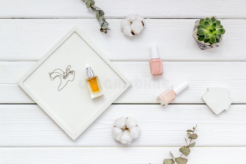 Work desk design with concrete decorations, nail polish and perfume on white wooden background top view. Home office. Work desk design with concrete decorations stock photo