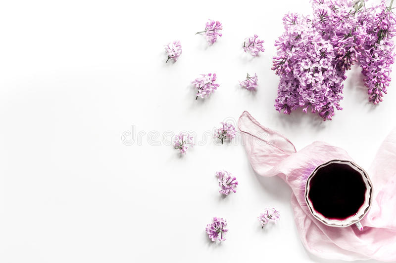 Work desk with lilac flowers in home office on white background top view space for text royalty free stock photo