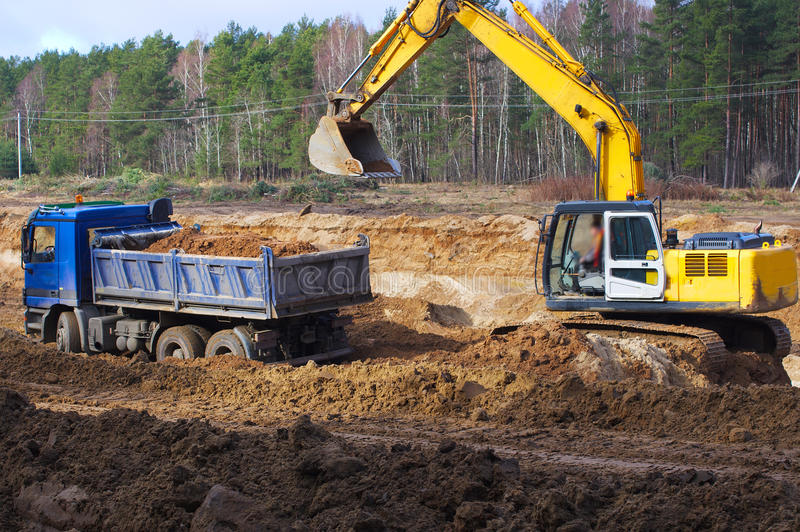 Work of digging ground and machines truck stock photo for Digging ground dream meaning