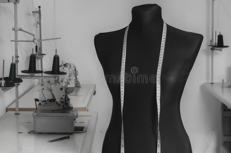 Work dummy on the background of sewing machines in a tailor workshop. Close-up royalty free stock images