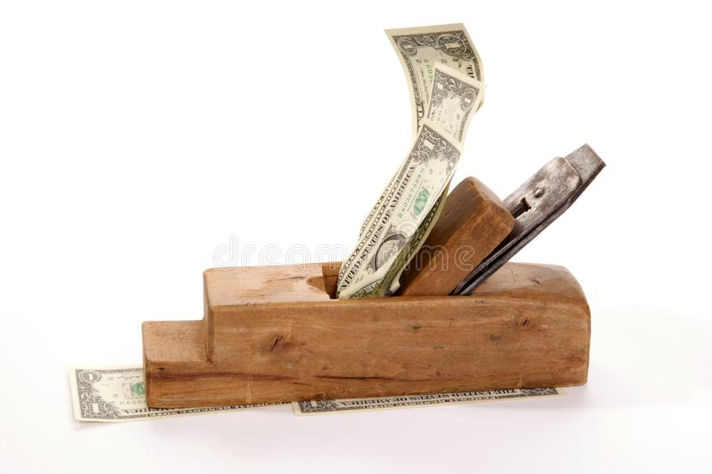 Work and earn. Old wood the planer and banknotes