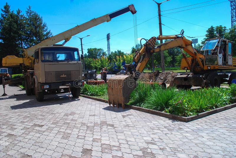 The work of the excavator on the scene royalty free stock photo