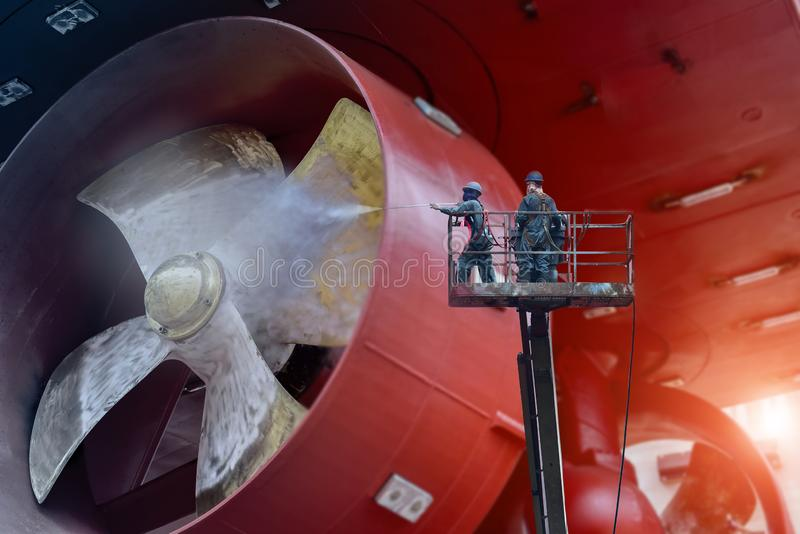 Ship Cleaning worker Washing by high pressure water royalty free stock photos