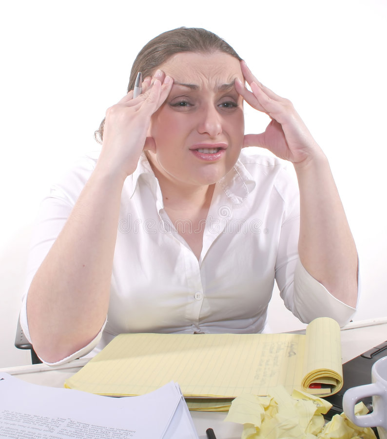 Work Frustration. A young brunette frustrated at the office royalty free stock photos