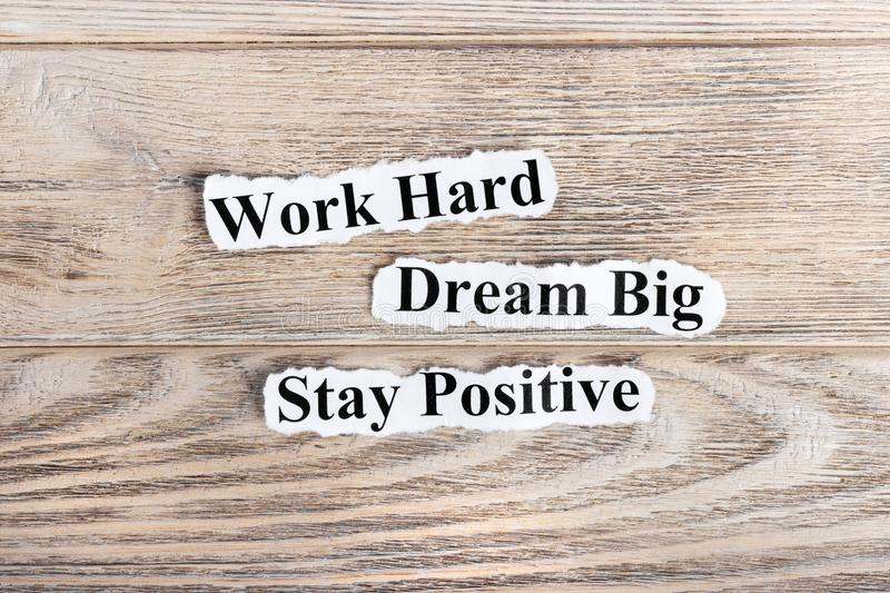 Work Hard, Dream Big, Stay Positive text on paper. Word Work Hard, Dream Big, Stay Positive on torn paper. Concept Image stock photos