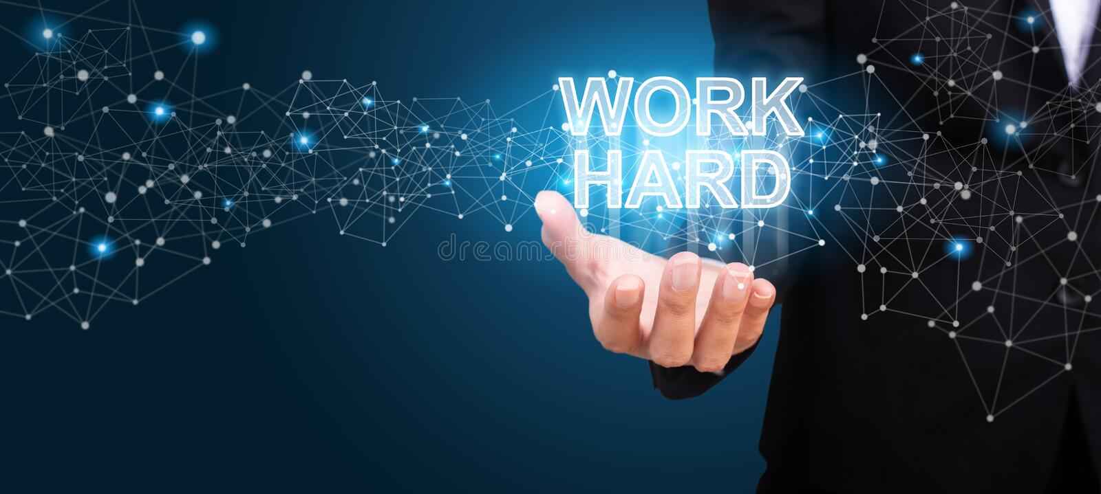 Work Hard in the hand of business. Work Hard concept stock images