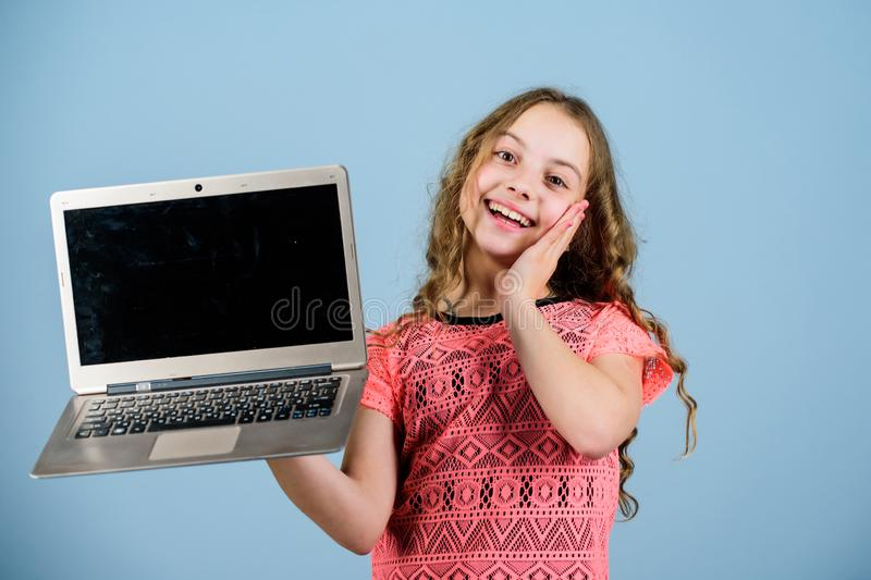 Work hard play harder. happy small girl with notebook. home schooling education. child development in digital age. video. Call by web cam. shopping online royalty free stock image