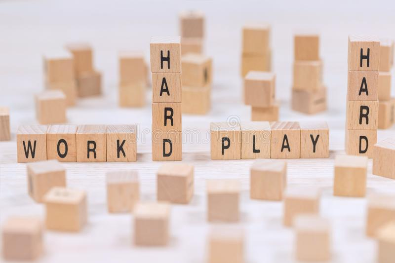 Work hard play hard wooden cubes background. A work hard play hard wooden cubes background stock photo