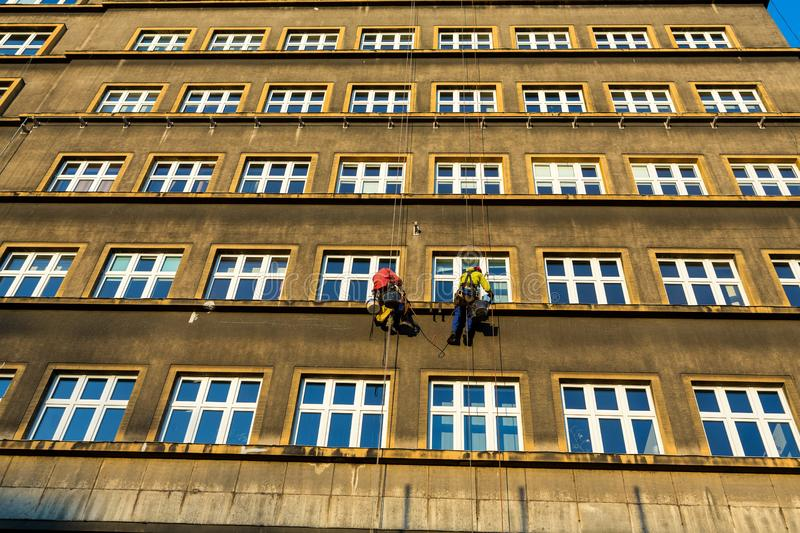 Work at height for the restoration of facade in Cracow. royalty free stock photo