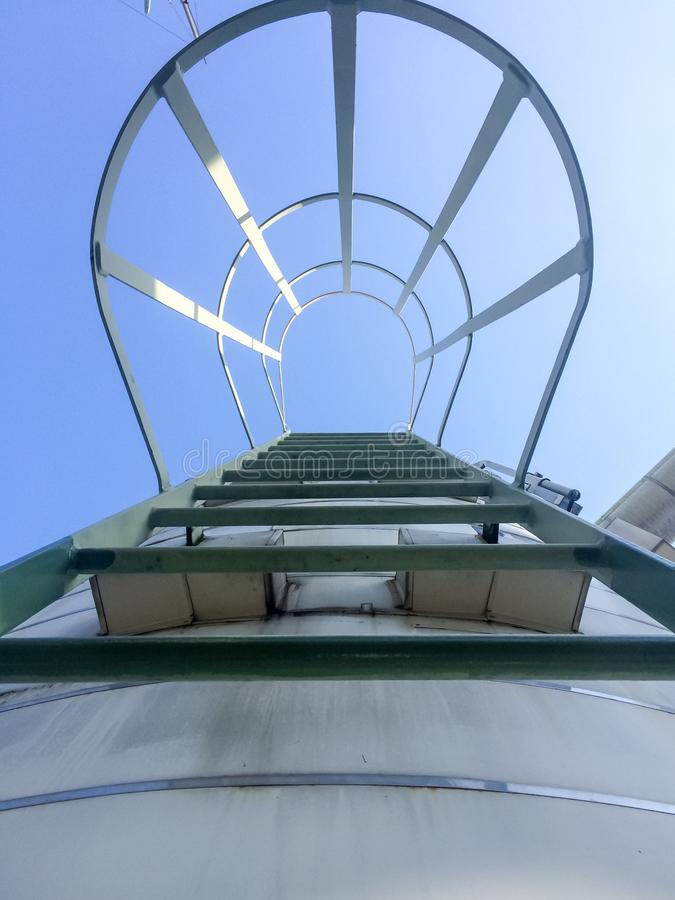 Work on high. Stairs higher than 2 meters Must have a protective steel frame on the back royalty free stock image