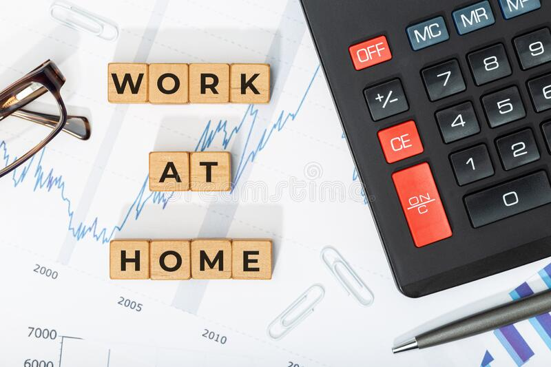 Work at home concept. Wooden blocks with phrase, calculator and printed charts. Business background royalty free stock photography