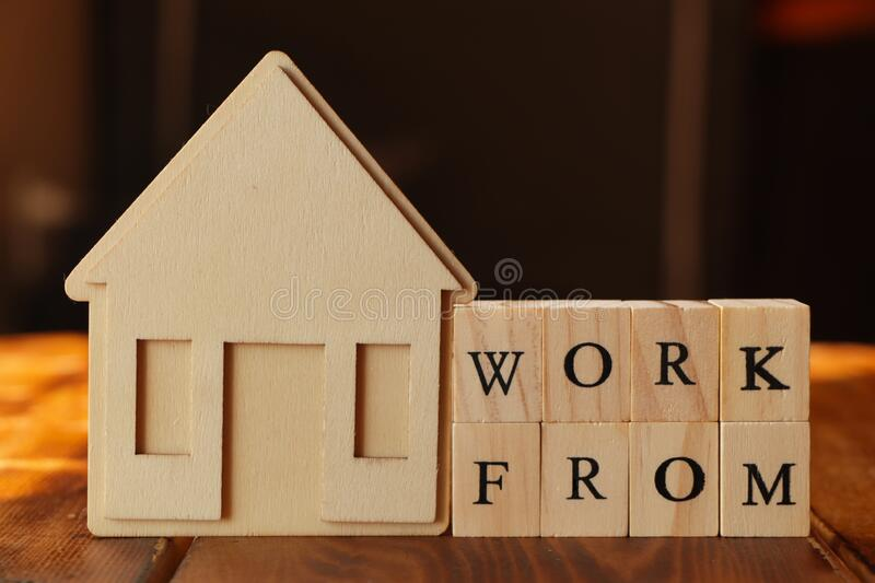 Work from home concept. Work from home concept with wooden blocks stock images