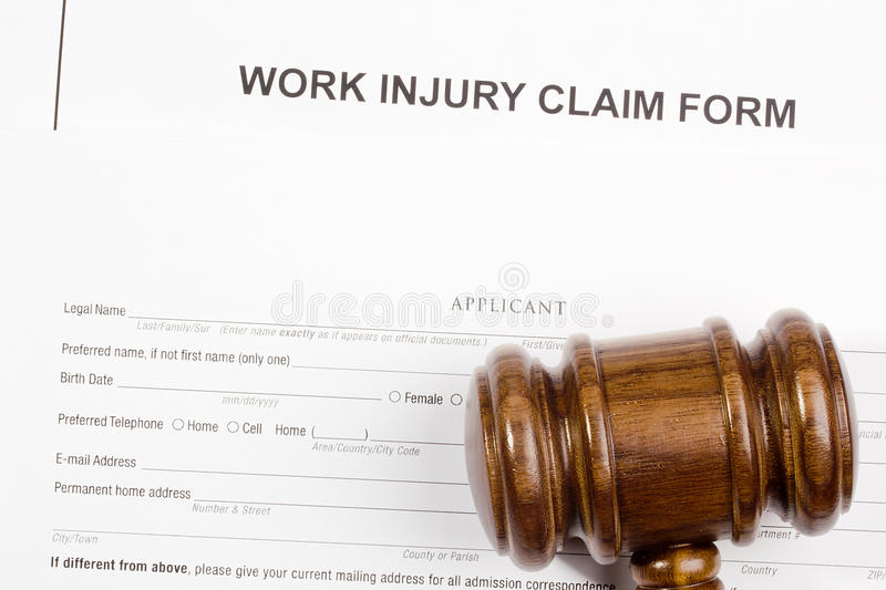 Work Injury Claim Form. Directly above photograph of a work injury claim form royalty free stock photography