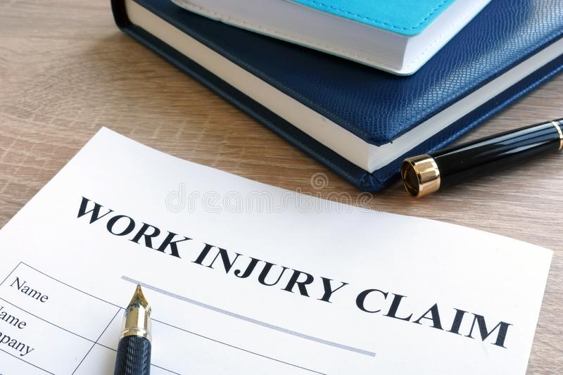 Work injury claim form and note pad. Work injury claim form, pen and note pad stock photos